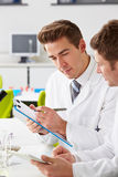 Two Technicians Working In Laboratory. Writing On Clip Bored Stock Image