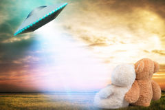 Two Teddy bear, looking at an unidentified flying object that appeared in the sky. Bear, looking at an unidentified flying object that appeared in the sky stock photo