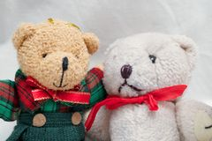 Two Teddy Bears as Friends Hugging showing their Friendship Holidays Celebrations. Cute adorable little teddy bears hugging each other as best friends Stock Photos
