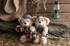 Two teddy bears in barn studio Stock Photo