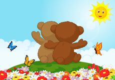 Two teddy bears cartoon sitting in the garden Stock Photography
