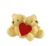 Two teddy bears with heart on white. Royalty Free Stock Photo