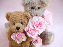 Two teddy bears holding roses Stock Image