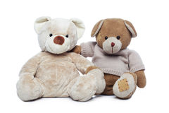 Two Teddy bears hugging each other. Over white background Royalty Free Stock Photos