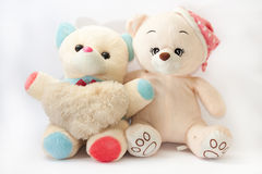Two teddy bears hugging like friends Stock Image