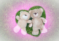 Two teddy bears laying down for Valentine background Stock Image