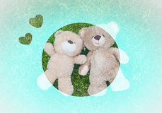 Two teddy bears laying down for Valentine background Royalty Free Stock Photo