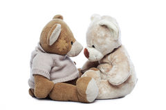 Two Teddy bears looking each other over white. Background Stock Photos