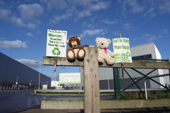 Two Teddy Bears Outside Recycling Plant Encouraging People To Recycle. Royalty Free Stock Image