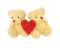 Two teddy bears with red heart on white. Royalty Free Stock Image