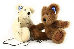 Two Teddy Bears Sharing Music With Headphones Stock Image