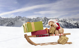 Two teddy bears on a sled outdoors Royalty Free Stock Photography