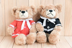 Two teddy bears on wood background Stock Photography