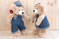Two teddy bears on wood background Royalty Free Stock Photo