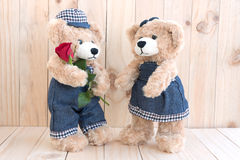 Two teddy bears on wood background Royalty Free Stock Images