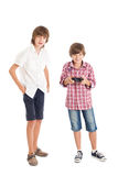 Two boys playing computer games Stock Photo