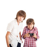 Two boys playing computer games. Two teen boys playing computer games Royalty Free Stock Photography