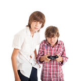 Two boys playing computer games. Two teen boys playing computer games Royalty Free Stock Photo