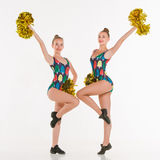 The two of teen cheerleaders posing at white studio Stock Images