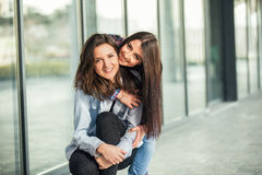 Two Teen Girl Friends Laughing. Selective focus Royalty Free Stock Photos