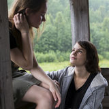 Two teen girl talking to each other. Frendship. Royalty Free Stock Photos