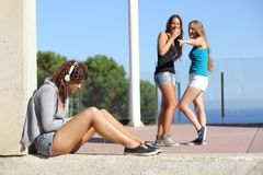 Two teen girls bullying another one. Two teen girls bullying and making fun and pointing another one Royalty Free Stock Images