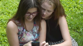 Two teen girls with cell outdoor stock video