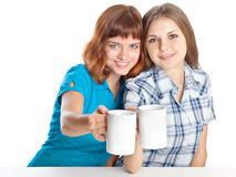 Two teen-girls are drinking tea Royalty Free Stock Photography