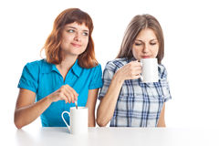 Two teen-girls are drinking tea Stock Photos