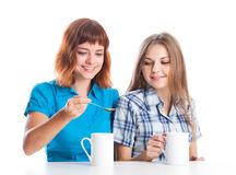 Two teen-girls are drinking tea Stock Photography