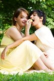 Two teen girls eating an apple Stock Photo