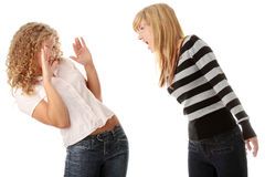 Two teen girls having an argue. Isolated on white Stock Photography