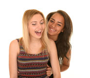 Two Teen Girls Laughing on White Background Stock Photo
