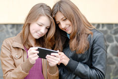 Two teen girls looking on tablet pc Stock Photos