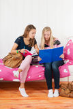 Two teen girls making homework together Royalty Free Stock Photo