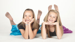 Two Teen Girls in Pantyhose Modeling Fashion Clothes in Studio Stock Image