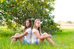 Two teen girls in  park Stock Image