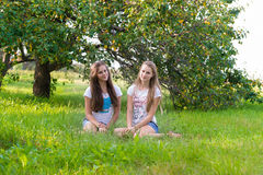 Two teen girls in  park Stock Images