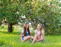 Two teen girls in  park Stock Photography
