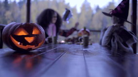 Two teen girls sharing candys after trick or treat on Halloween stock video footage