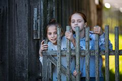Two teen girls sisters outdoors in the village. stock image