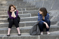 Two  teen girls sitting on stairs Royalty Free Stock Image