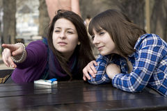 Two teen girls sitting in street cafe Royalty Free Stock Photos