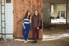 Two teen girls standing at the iron door Stock Photos