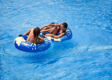 Two teen girls in the swimming pool. Two teenager girls in the swimming pool Royalty Free Stock Images