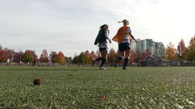 Two teen girls warming up soccer. Young athletes training Vancouver Canada November 2016 stock video footage