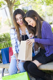 Two Teen Mixed Race Women Looking Into Bags Stock Photography