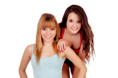 Two teen sisters isolated Stock Photos