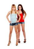Two teen sisters with jeans shorts Royalty Free Stock Photo