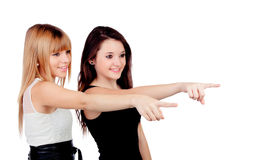 Two teen sisters pointing Stock Photography